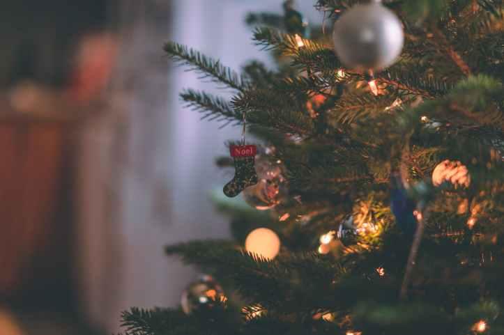 macro shot photography of christmas stockings ornament on a christmas tree
